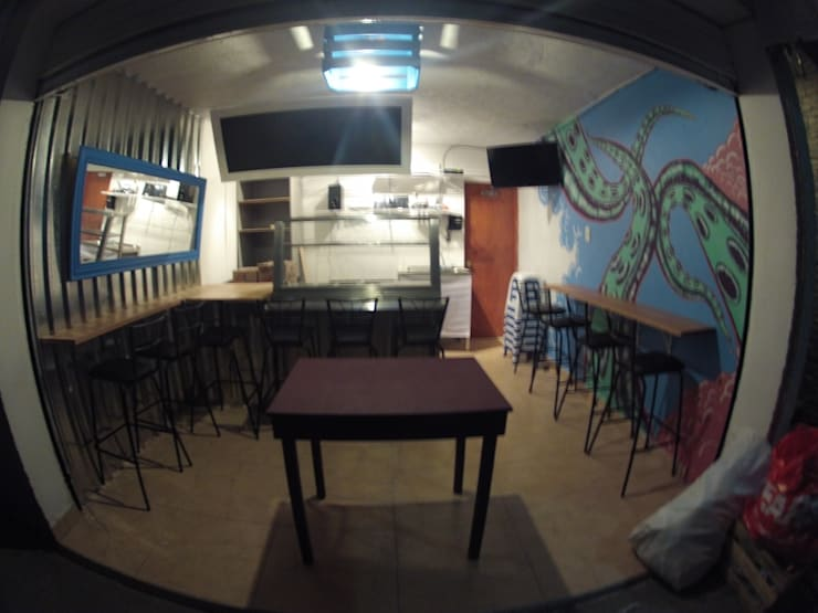 interior: Restaurantes de estilo  por Armatoste studio