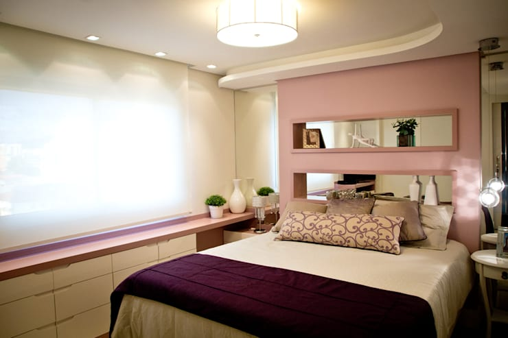 Dormitorios de estilo ecléctico por INOVA Arquitetura