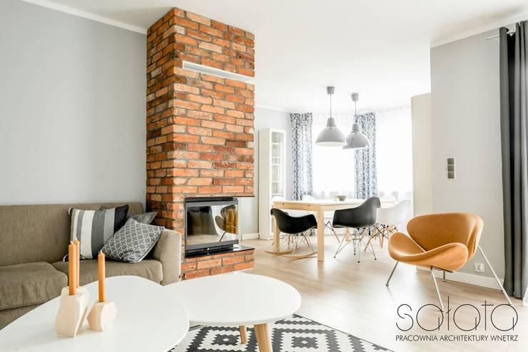 Dom jednorodzinny, Maszewo.: styl , w kategorii Salon zaprojektowany przez Sałata-Pracownia Architektury Wnętrz