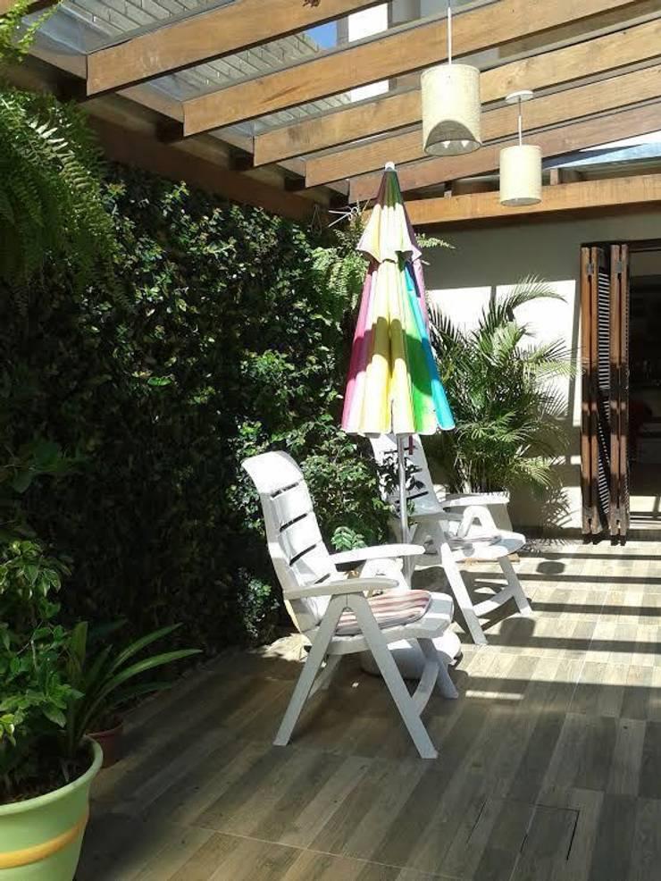 Paisagismo zona Norte de Porto Alegre: Jardins modernos por Elaine Medeiros Borges design de interiores