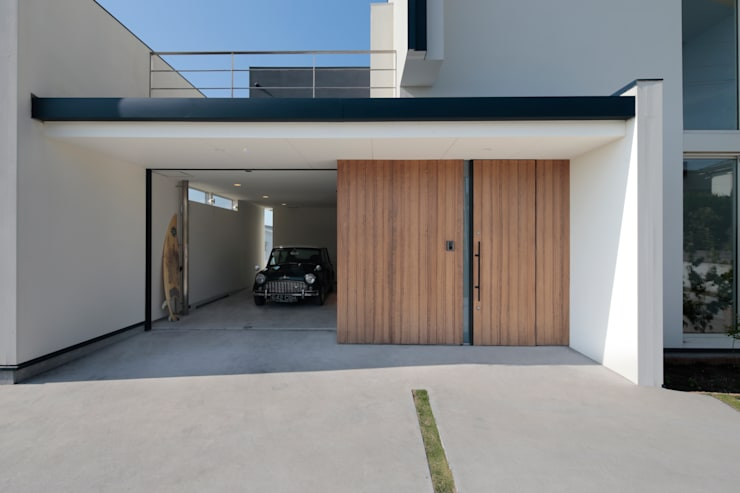 趣味の時間を存分に愉しむ家: 河崎建築計画事務所が手掛けた家です。