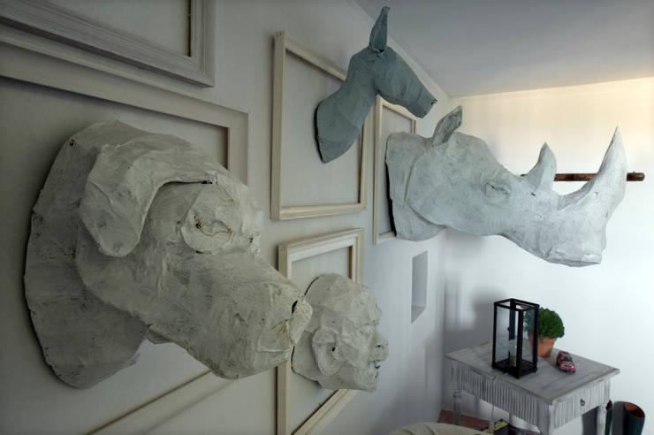Esculturas de Javier Requejo: Arte de estilo  de Oito Interiores