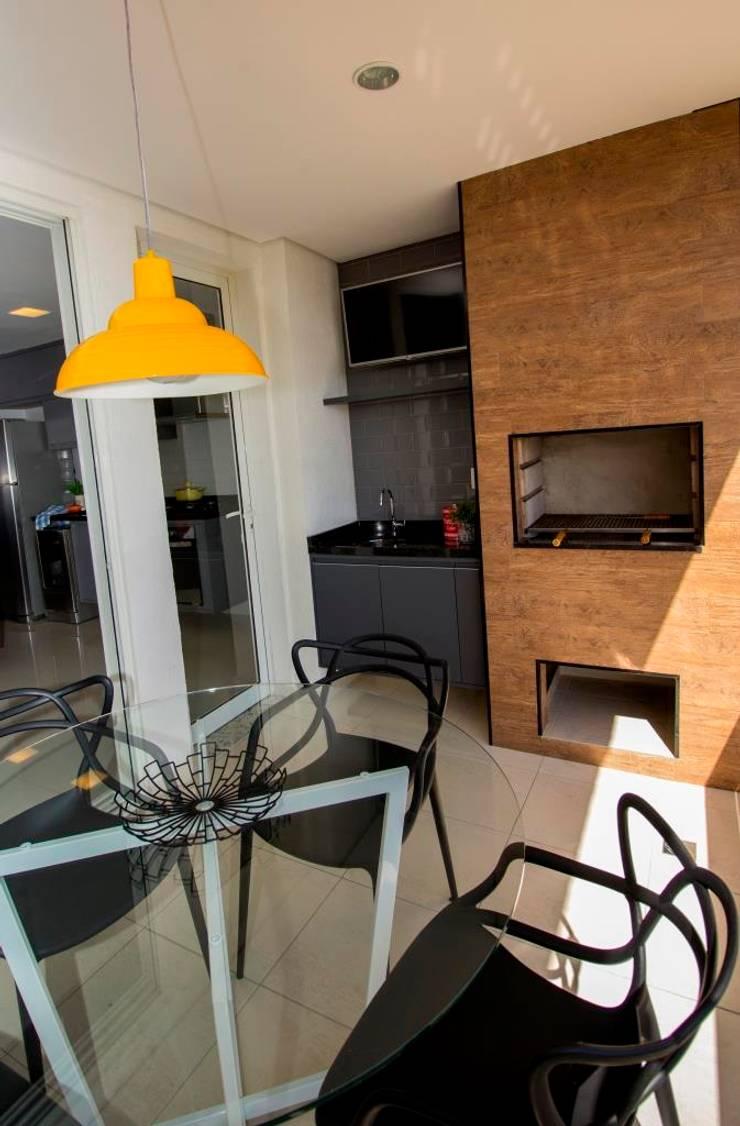 Apartamento Tamboré: Terraços  por Le Haus - Arquitetura +Design