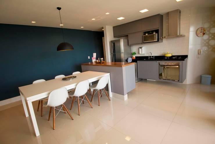 Apartamento Tamboré: Salas de jantar  por Le Haus - Arquitetura +Design