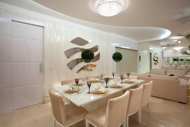 Apartamento Jatobá: Salas de jantar  por Designer de Interiores e Paisagista Iara Kílaris