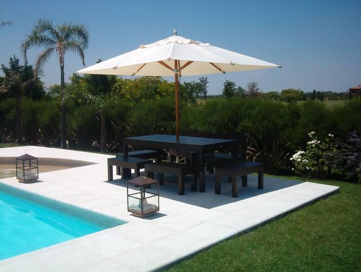 Mobiliario para exteriores: Piletas de estilo  por El Naranjo
