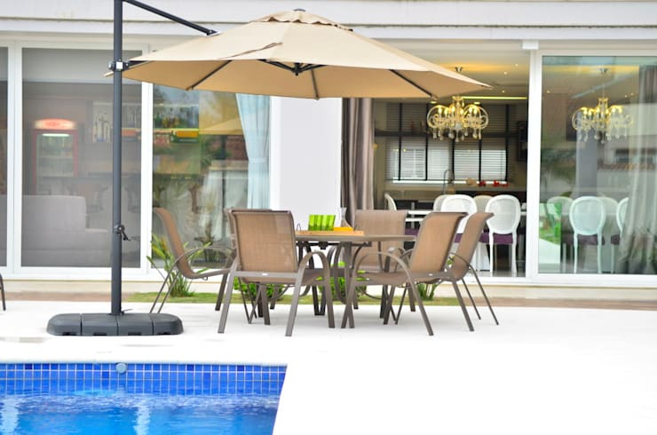 Residencia Unifamiliar: Piscinas  por Marcelo John Arquitetura e Interiores