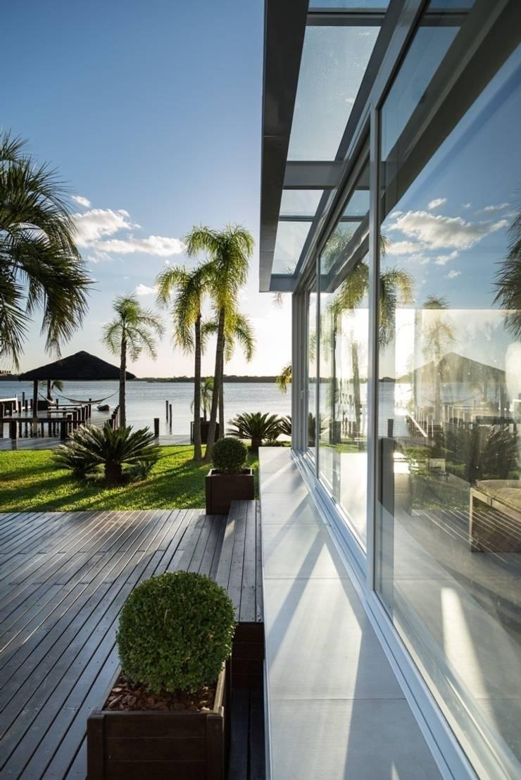 Quiosque Ilha dos Marinheiros: Casas  por Kali Arquitetura,