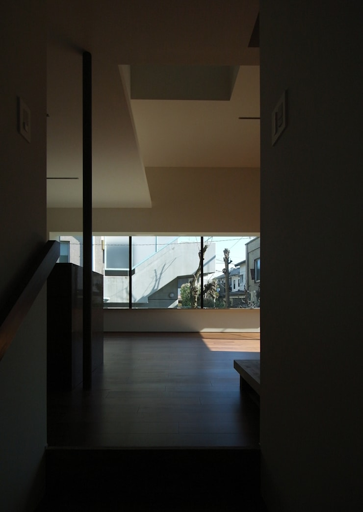 PIANO: 充総合計画 一級建築士事務所が手掛けたリビングです。,
