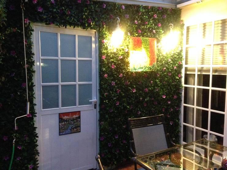 follaje azalea : Casas de estilo  por Armatoste studio