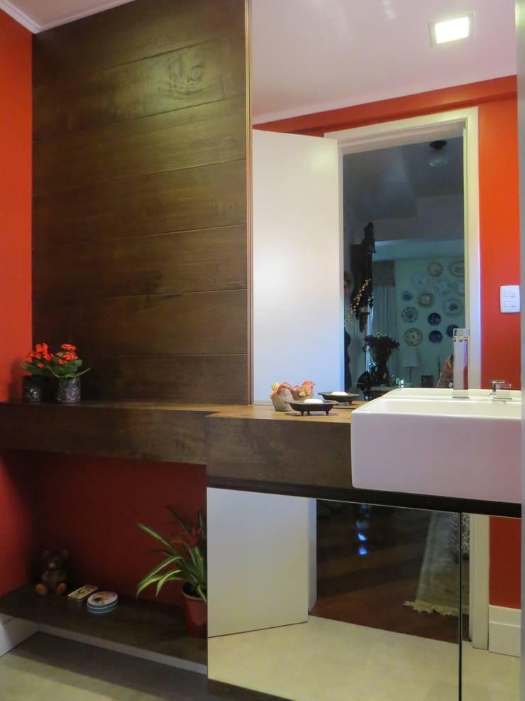 Lavabo: Banheiros  por Paula Szabo Arquitetura,Rústico