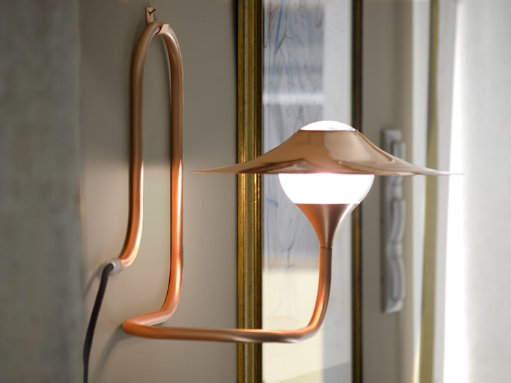 Copper: modern Living room by Intuerilight