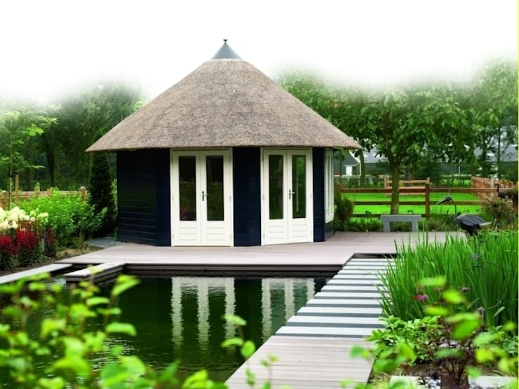 Thatched Octagonal Summerhouse:  Garden by Garden Affairs Ltd