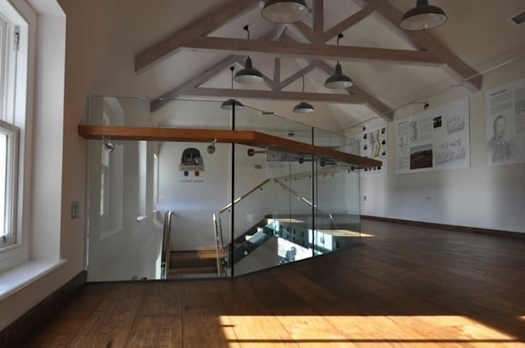 Frameless glass for mezzanine floor:  Terrace by Ion Glass
