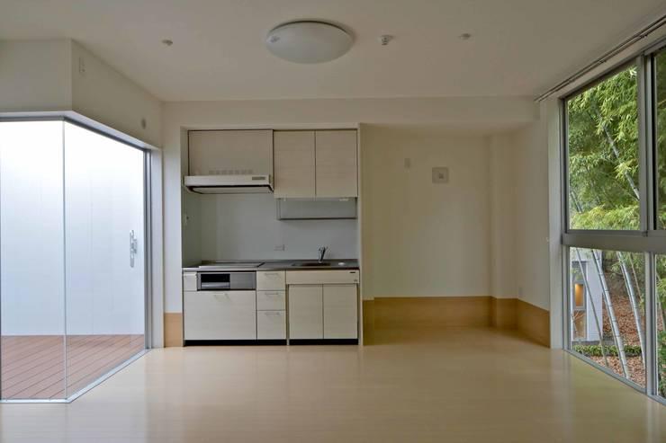 1DK40㎡タイプ: 株式会社ヨシダデザインワークショップが手掛けた寝室です。,モダン