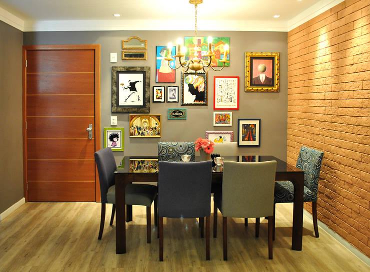 Sala tijolinhos: Salas de jantar modernas por Red Studio