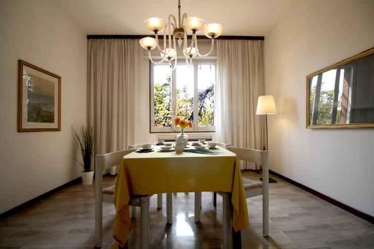 La sala da pranzo:  in stile  di Michela Galletti Architetto e Home Stager