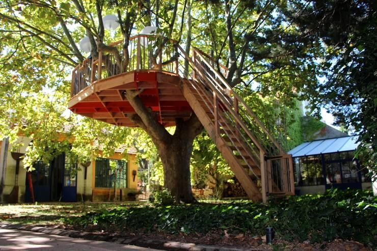 Terrasse a Aix en Provence: Terrasse de style  par Cabaneo