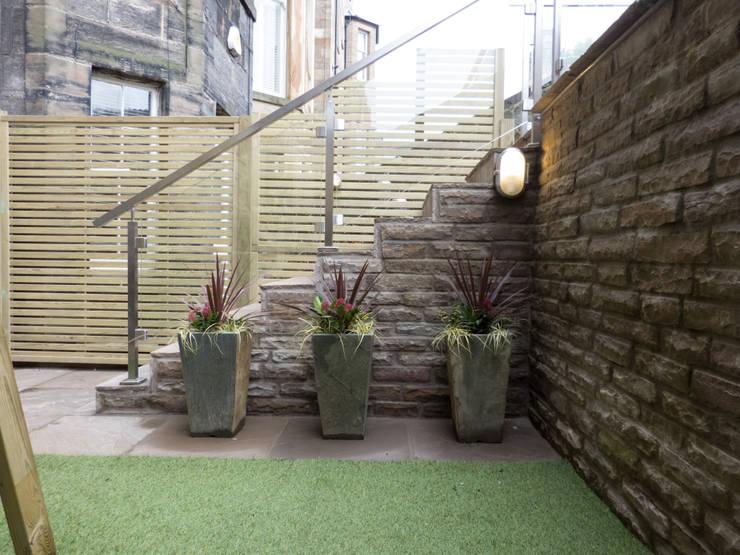 de estilo  por Anne Macfie Garden Design