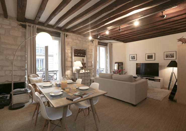 Décoration d'un appartement ancien: Salon de style  par Xavier Lemoine Architecture d'Intérieur