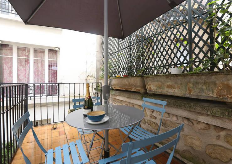 Terrazza in stile  di Xavier Lemoine Architecture d'Intérieur