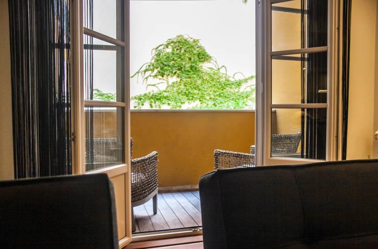 Reabilitação Apartamento Chiado: Terraços  por Architecture Tote Ser