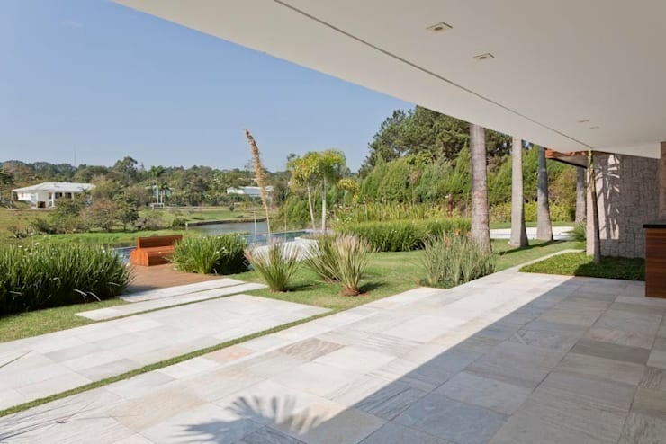 Residência Itu: Terraços  por Maristela Faccioli Arquitetura,Moderno