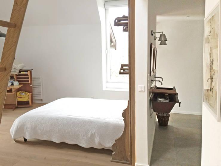 Camera da letto in stile in stile Eclettico di Atelier DCCP Architectes