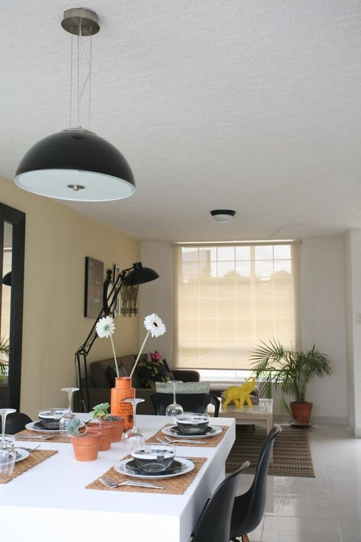 Sala-comedor.: Salas de estilo  por Dovela Interiorismo