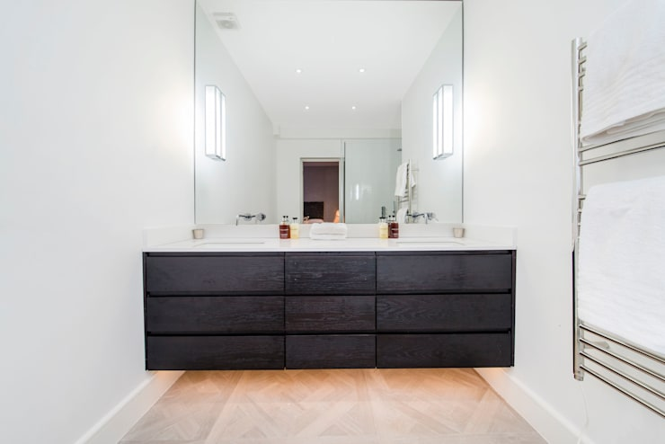 Parquet flooring and underlit counters:  Bathroom by Balance Property Ltd