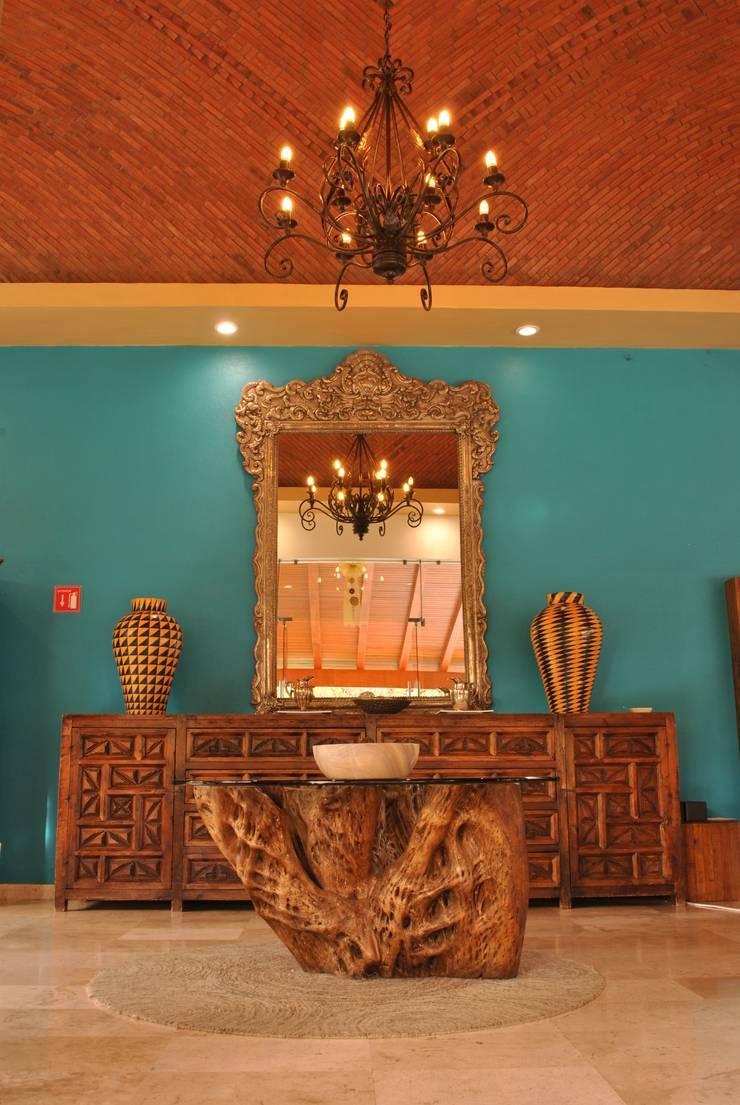 Lobby.: Hoteles de estilo  por Dovela Interiorismo