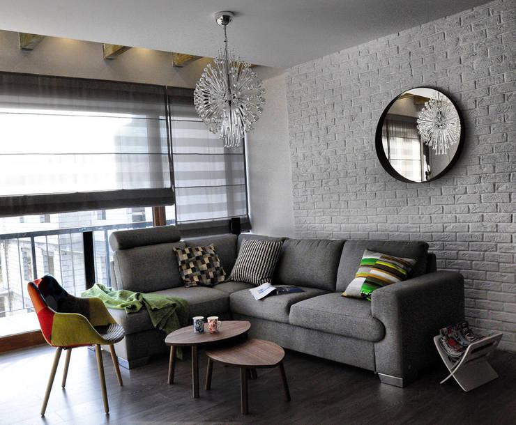 Mieszkanie dwupoziomowe w Kiełczowie: styl , w kategorii Salon zaprojektowany przez Pracownia Kaffka