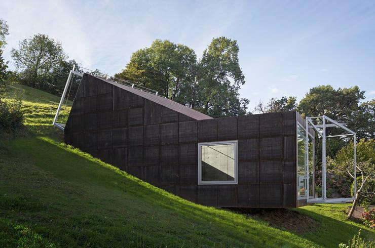 Casas de estilo ecléctico de Spiegel Fassadenbau