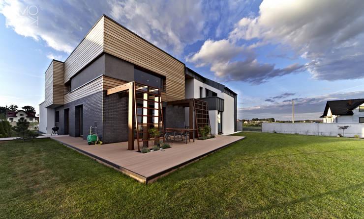 Nowoczesna rezydencja pod Krakowem: styl , w kategorii Domy zaprojektowany przez Pracownia projektowa artMOKO