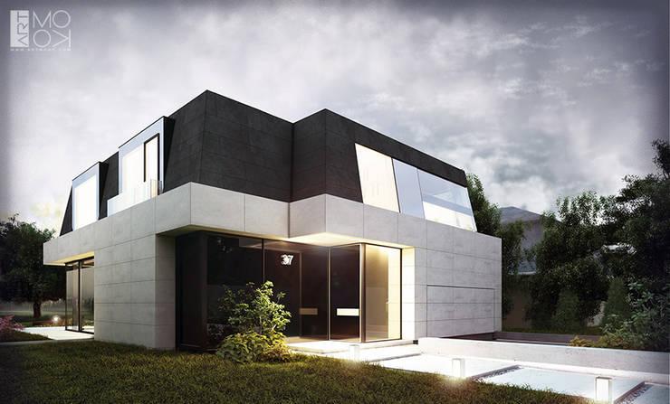 Nowoczesna rezydencja z klasycznym dachem mansardowym: styl , w kategorii Domy zaprojektowany przez Pracownia projektowa artMOKO