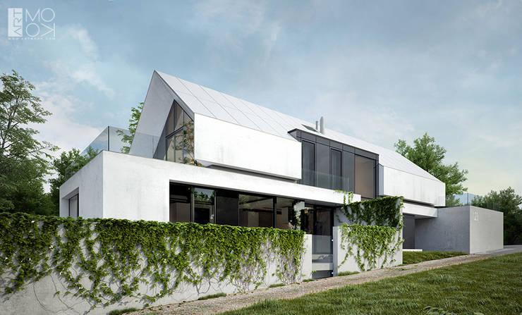 Rezydencja z ultra nowoczesną elewacją: styl , w kategorii Domy zaprojektowany przez Pracownia projektowa artMOKO