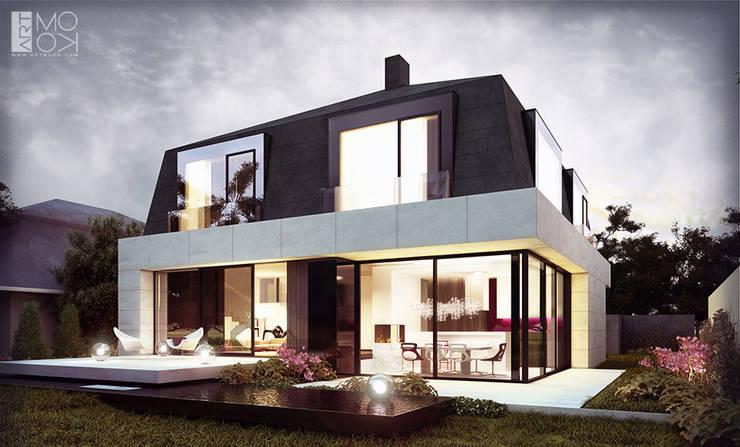 Houses by Pracownia projektowa artMOKO, Modern