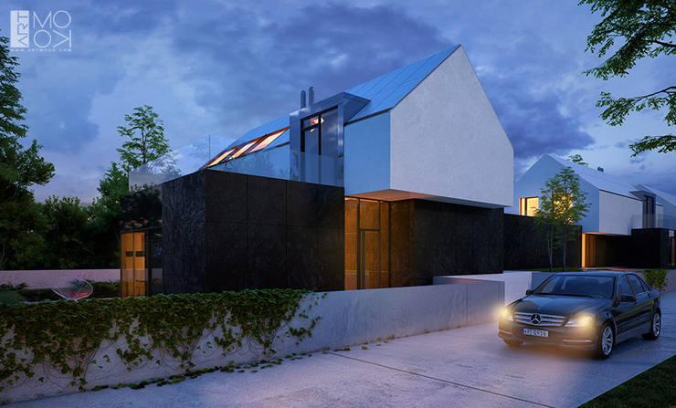Minimalistyczna elewacja budynków: styl , w kategorii Domy zaprojektowany przez Pracownia projektowa artMOKO