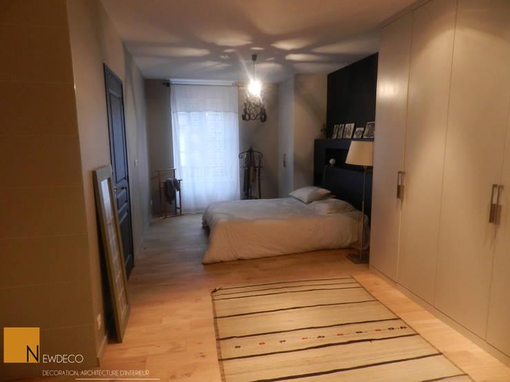 Rénovation d'un appartement centre ville Fougères: Chambre de style  par NEWDECO