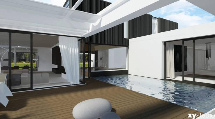 Dom Jednorodzinny DiW2012: styl , w kategorii Taras zaprojektowany przez xystudio