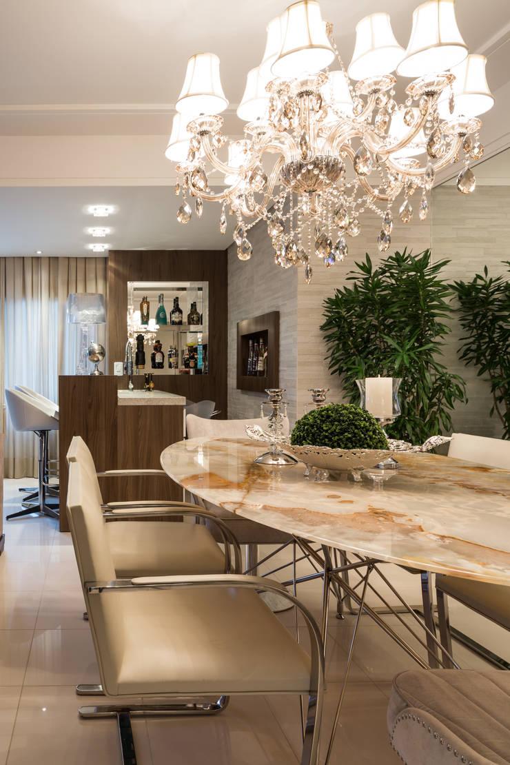 Apartamento Bela Vista 3: Salas de jantar  por Mundstock Arquitetura