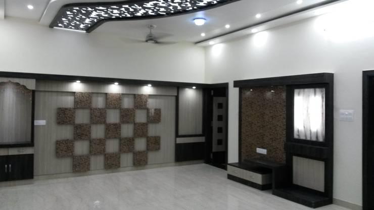 LALIT KUMAR FULWANI:  Living room by MAA ARCHITECTS & INTERIOR DESIGNERS