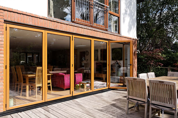 Folding sliding doors to new deck:   by Dye Tabrett Architects