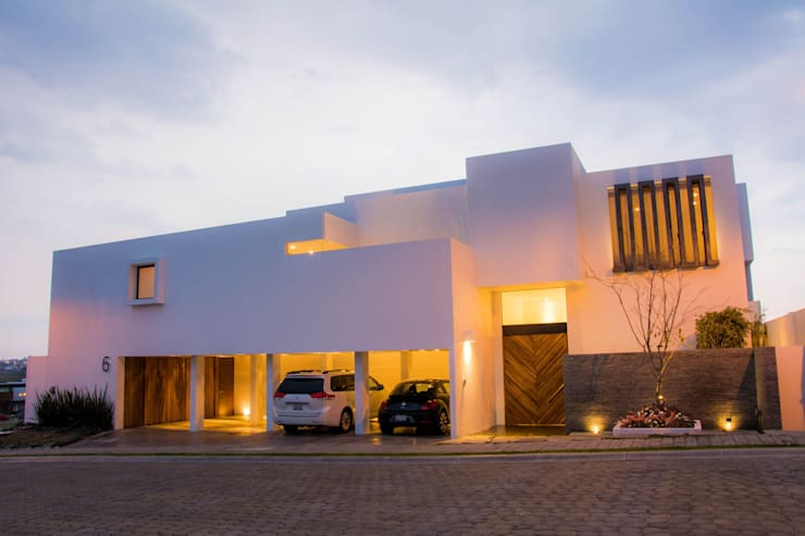 Houses by [TT ARQUITECTOS]