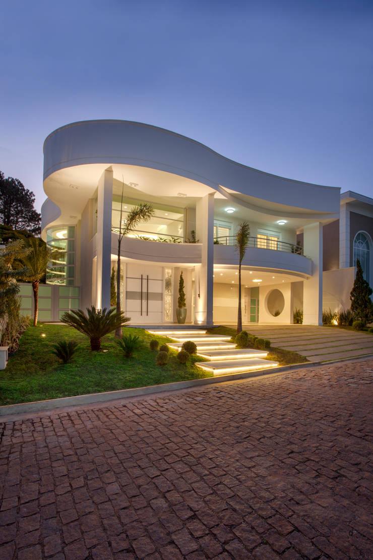 Casa Buriti: Casas  por Arquiteto Aquiles Nícolas Kílaris