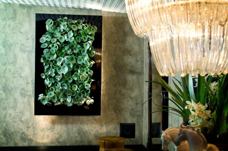Quadro Vivo® : Sala de estar  por Quadro Vivo Urban Garden Roof & Vertical