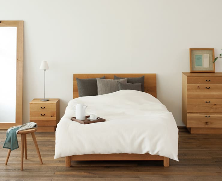 森のことば: 飛騨産業株式会社が手掛けた寝室です。,