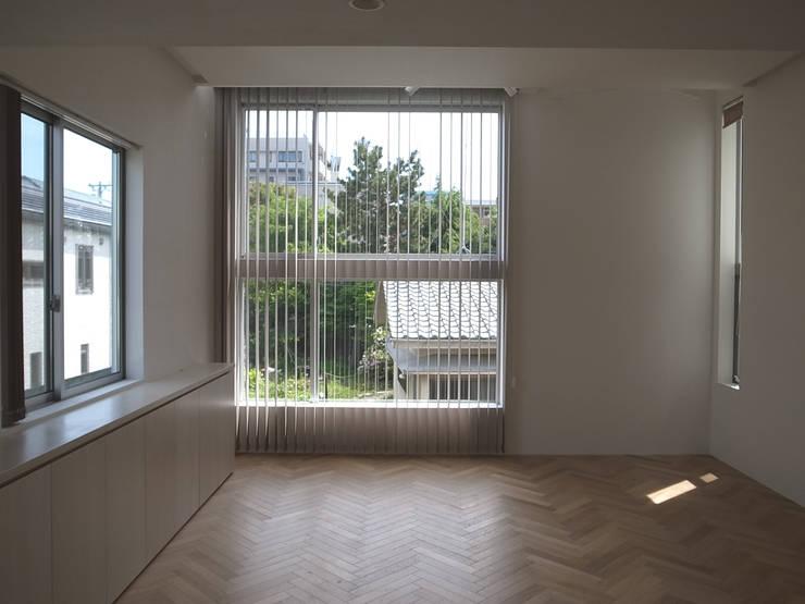 ムサシコスギ K邸: 有限会社スタジオA建築設計事務所が手掛けたリビングです。