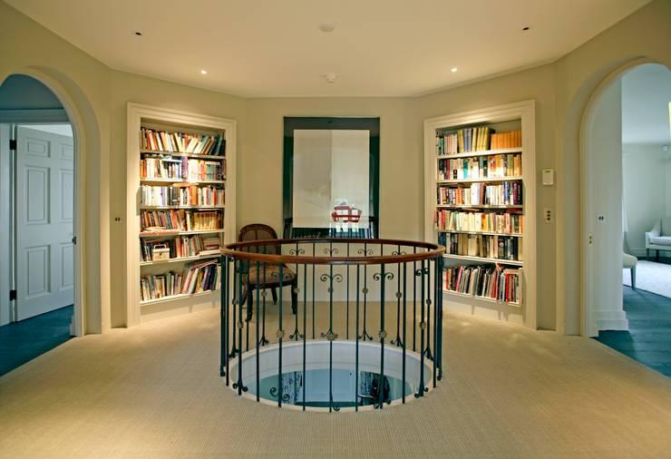 Landing bookcases:  Corridor & hallway by Giles Jollands Architect