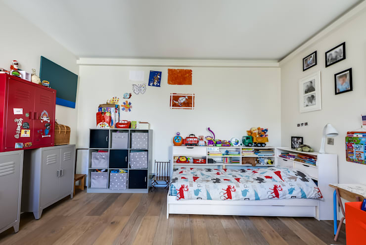 Levallois 110m2: Chambre d'enfant de style  par blackStones